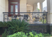Hand-forged wrought iron balcony railings from vie